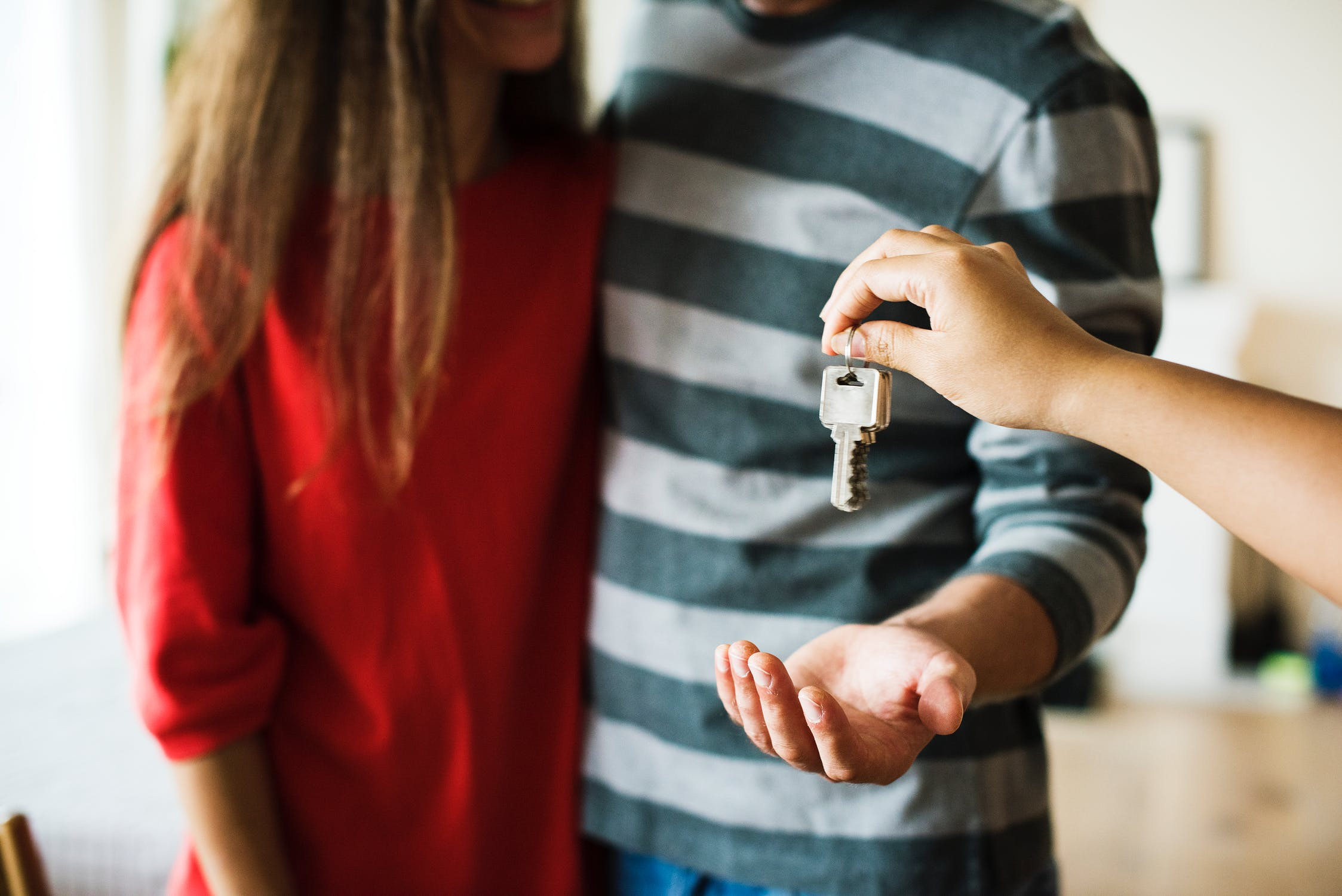 Couple getting the keys to a house